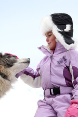 little girl stroking dog at ski