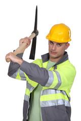 Craftsman holding a pick ax