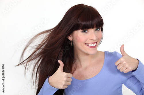 Brunette giving thumbs-up gesture