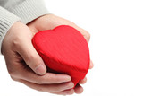 Hand hold heart shaped gift box