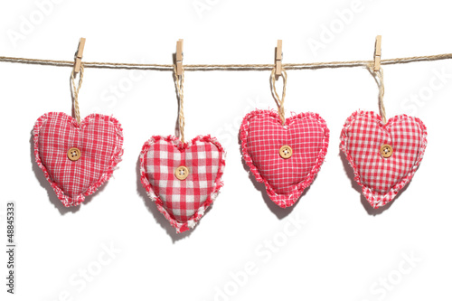 Homemade hearts hanging on clothes line