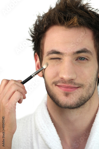 Man applying make-up