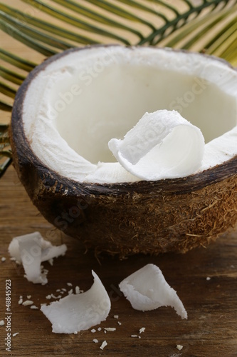 half a fresh coconut on a wooden table