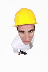 angry businessman wearing a helmet
