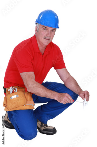 mature craftsman squatting