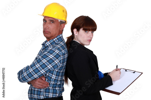 Architect and an engineer with a clipboard