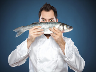 Male chef with seabass fish