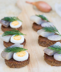 Six small canapes with herring