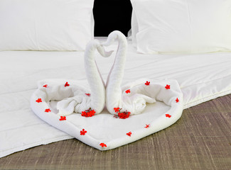 room in a hotel with swans from the towel on the newlyweds bed