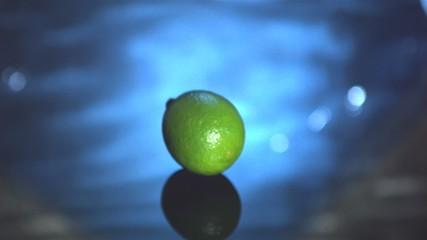 Lime fruit falling in water