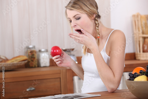 Woman yawning over breakfast