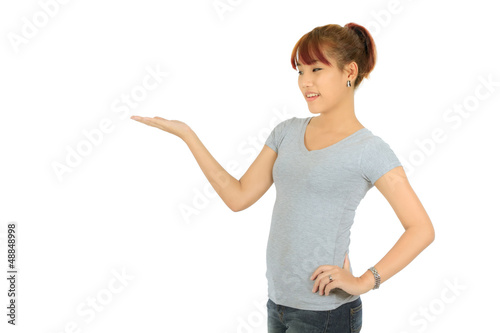 Isolated young asian woman presenting over white