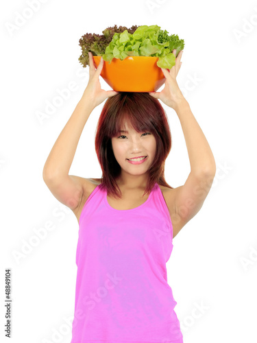 Isolated young asian woman with ca bowl of various vetgetables