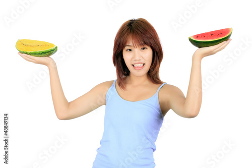 Isolated young asian woman with pieces of red and yellow waterme