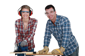 Tradesman training his apprentice