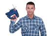 carpenter holding sander machine