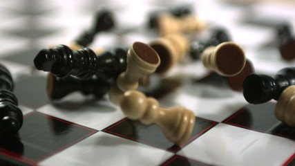Chess pieces crashing on board