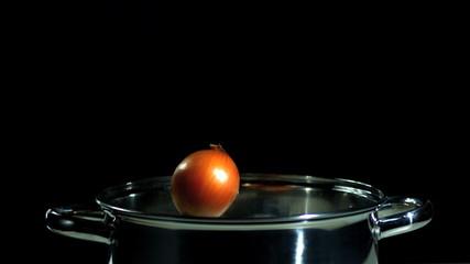 Onion falling in pot