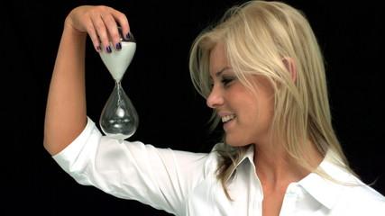 Blonde watching an hourglass