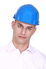 A mane wearing a hardhat.