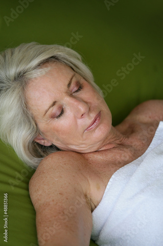 Woman asleep in a spa