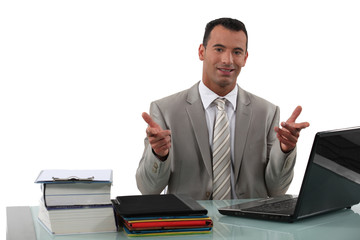 Arrogant businessman sat at desk