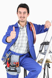 plumber with all his equipment making a thumbs up sign