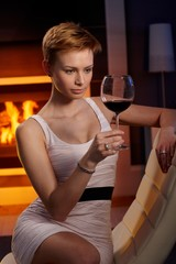 Sexy woman with a glass of wine