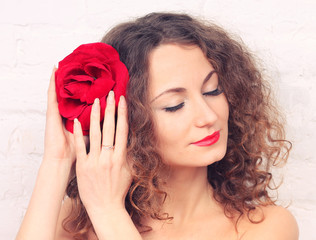 Beautiful girl with big red flower