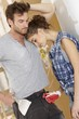 Exhausted young couple at home renovation