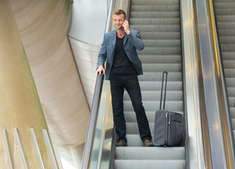 Businessman on Escalator