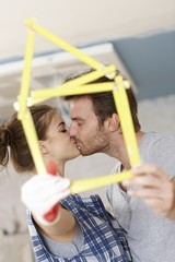 Kissing couple renewing home