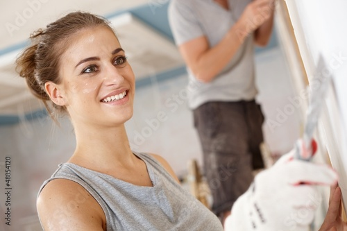 Attractive woman renewing house