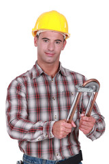 Tradesman using a tube bender