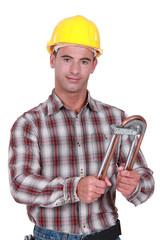 Tradesman using a tube bender