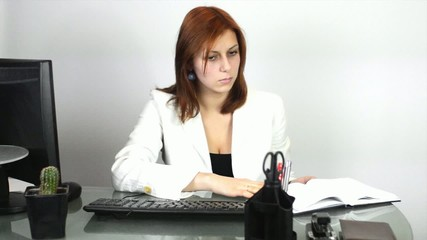 female manager writing in a notebook