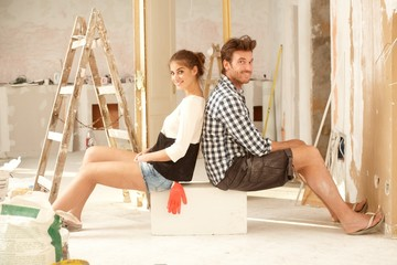 Happy couple renovating home