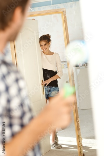Attractive woman in renovated house