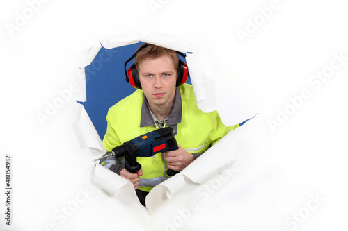 Worker with ear muffs
