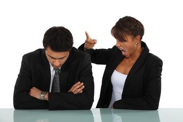 Woman reprimanding her employee