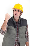 Construction worker raising his fist