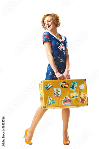 Beauty young girl with suitcase in hand