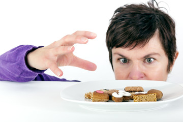 Woman reaching for cake plate