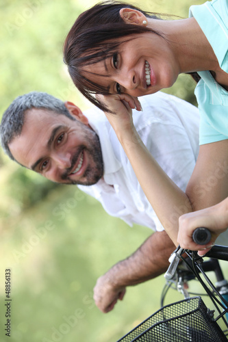 Couple riding their bikes together