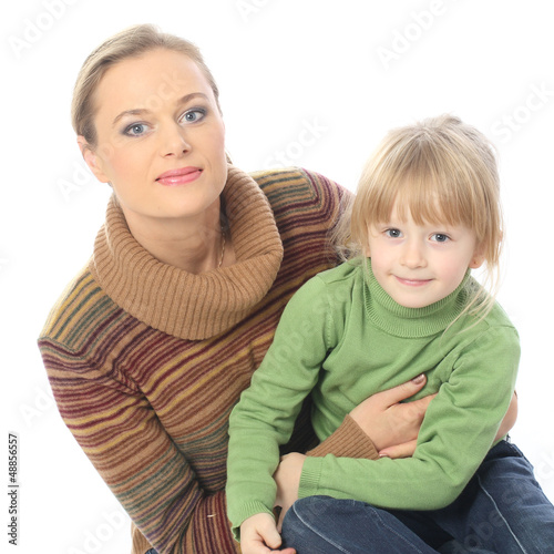 Young modern mother holds a daughter