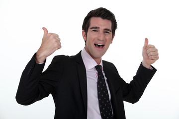 Portrait of a businessman rejoicing