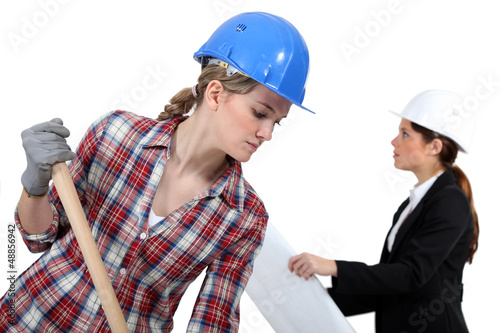 Labourer working beside an engineer