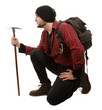 Adventurer hiker with backpack and pick
