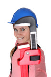 Woman holding pipe wrench