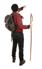 Adventurer hiker with rod view from back